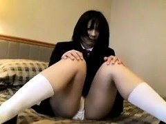 Lovely Asian schoolgirl flashes her sweet body and her whit
