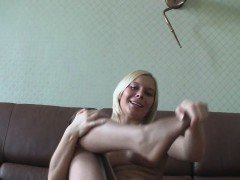 Hot naked blonde puts on some pantyhose