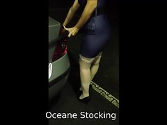 In micro dress and white stockings in a gas station UPSKIRT
