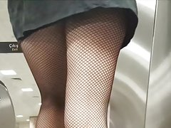 Sexy legs in Black Fishnet Pantyhose Upskirt
