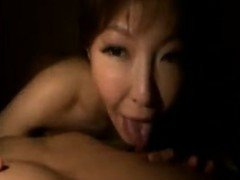 Buxom Oriental beauty spreads her legs and gets fucked with