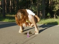 sexy teen pissing on the road in the forest