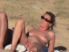 Lustful Couple Caught Naughty On The Nude-Beach