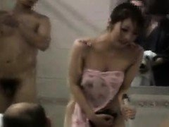 Japanese girl gets stripped for the customers of a public b