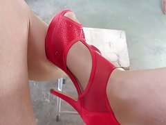 touching the legs with my wifes red high heels