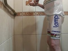 Masturbating under shower in white bicycle clothing
