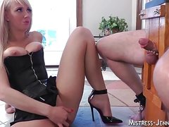 Tall blonde femdom Mistress punishes slave in chair