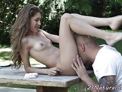 Petite beauty pounded on the table outdoors
