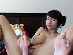 HOT ASIAN TEEN PLAYS WITH DILDO AND SQUIRTS ON CAM