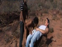 Slave from Africa takes two big dicks outdoors