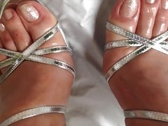 Oiled Feets with silver Toes in silver strappy Stilettos
