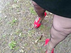 Masturbating outside in nylons and high heels