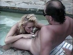 Mature couple having sex in a pool