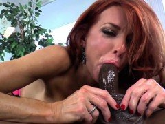 Redhead domina pegs sub and makes him cum