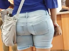 Candid big booty Mexican milf in tight Jean shorts.