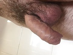 Real horny guy gets uncut hairy cock hard after shower