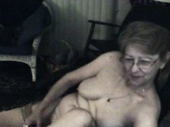Granny really enjoys shoving her toys in her old pussy