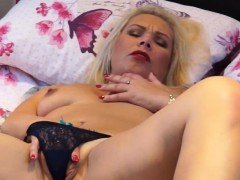 Small titted blonde mature masturbating on the bed