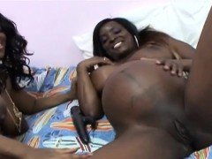 Pregnant ebony lesbians play with toy in bedroom