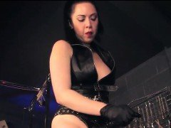 Strapon Mistress and Male Slave in BDSM Room