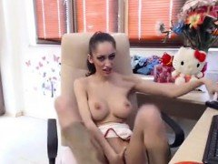 Horny kitty girl slowly looses her clothes while chatting