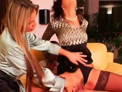 Lustful lesbians using toys in fully dressed pissing play