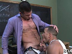 Horny gay lad gives top blow job on a large dick at school