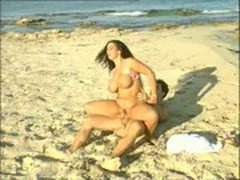 Busty Tiziana Redford sex on the beach