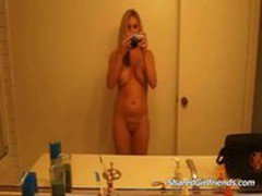 Hot girl posing nude in the bathroom