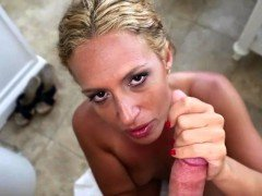 Pretty MILF wanks and sucks cock in POV