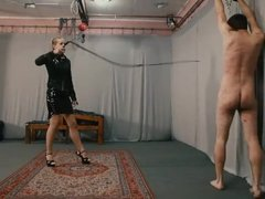 Cruel whipping by sadistic blonde dominatrix in leather