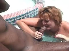 Redhead MILF Dawn takes BBC in a pool