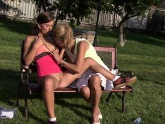 Old mother toying her young pussy outdoors