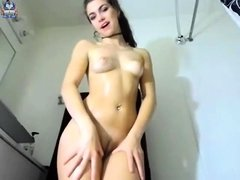 Tall brunette fingers and toys her wet pussy solo