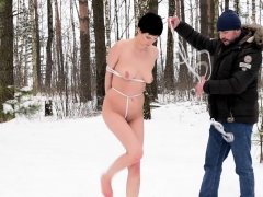Naked and barefoot girl in snow bondage