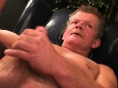 Muscular mature plumber stroking his stiff fat cock
