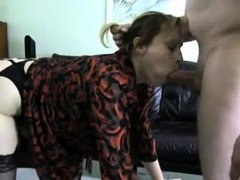 Blonde busty whore in red stockings gives blowjob