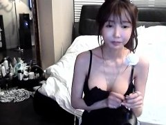 Busty Japanese uses her boobs