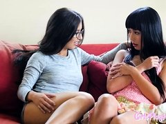 Asian lesbian scissoring beauty on the couch