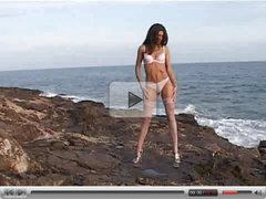 Tall girl in pink undies on the rocks  FM14