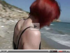 Cute redhead stripped on beach  FM14