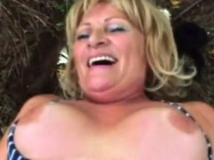 Horny granny jumps on top outside