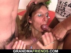 Hairy old mature woman swallows two cocks at once