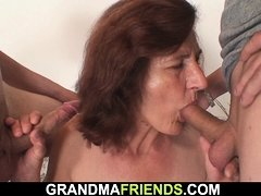 Old lady sucking and riding two cocks at once
