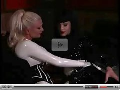 Kinky latex lesbian lovers play with their slave