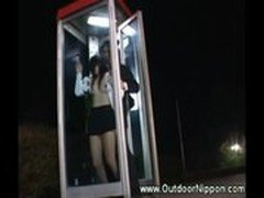 Horny and wet asian gives blowjob in phone booth