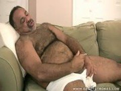 Stocky daddy plays with his dick