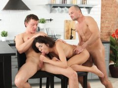 Cute brunette Katty has a hot threesome in the kitchen