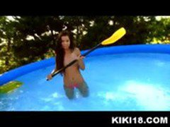 Hot teen Kiki fooling around in her outdoor swimming pool