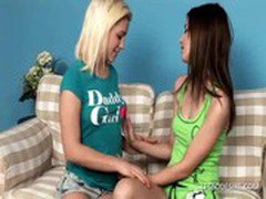 Lesbian vixens remove their tops to suck and fondle
